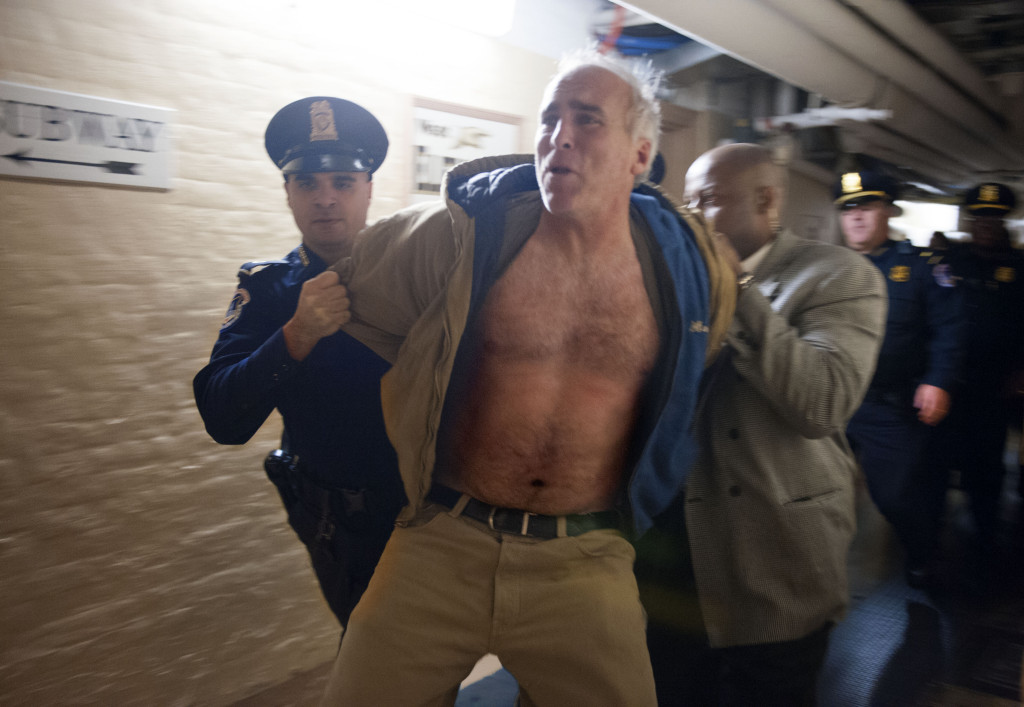 Protester Rives Grogan is taken through the U.S. Capitol basement under arrest after disrupting the U.S. Senate by shouting anti-abortion slogans from the visitors' gallery on Dec. 29, 2012.