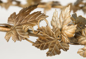 Leaf in gold finish in table detail for Salvations Architectural Furnishings.