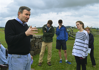 Retired Lt. Gen. Karl Eikenberry, former U.S. ambassador to Afghanistan, discusses the battle of Gettysburg with students from Stanford's CISAC honors program in Gettysburg, PA. Standing beyond Gen. Eikenberry are two other veterans of the Afghanistan & Iraq wars.