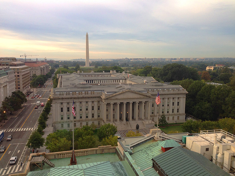 A morning view of the U.S Treasury Building and the Washington Monument beyond it.
