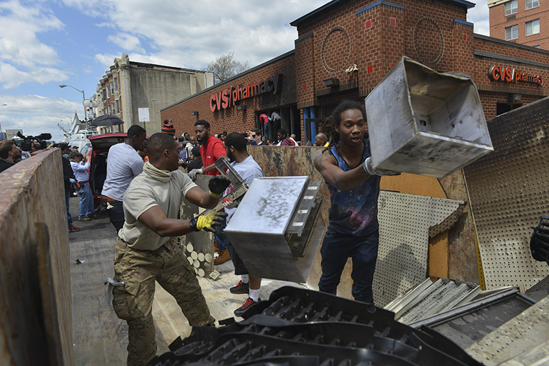 Neighbors and Volunteers Work to Restore Looted Baltimore Store