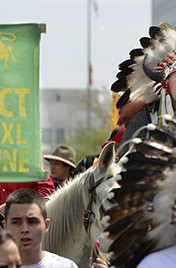 Members of the Cowboy and Indian Alliance ride horses and march down Independence Avenue as a coalition of ranchers, farmers and native American tribes begins a multi-day protest against  the Keystone XL pipeline on the National Mall.