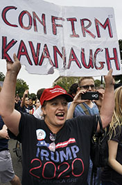 A pro-Trump, pro-Kavanaugh protester is among hundreds of protesters who flooded the front of the U.S. Capital and Supreme Court as the U.S. Senate voted to confirm Judge Brett Kavanaugh to a seat on the U.S. Supreme Court. Police arrested dozens during the protests. Photo:  Jay Mallin    jay@jaymallinphotos.com